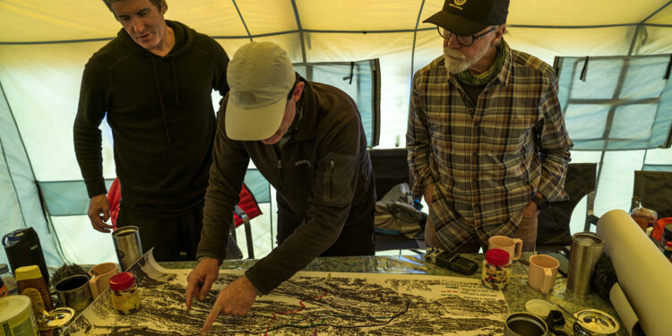 Team members Mark Synnott, Jamie McGuinness, and Thom Pollard map out a plan to climb the North side of Mt. Everest in search of Sandy Irvine's remains. (National Geographic/Renan Ozturk)