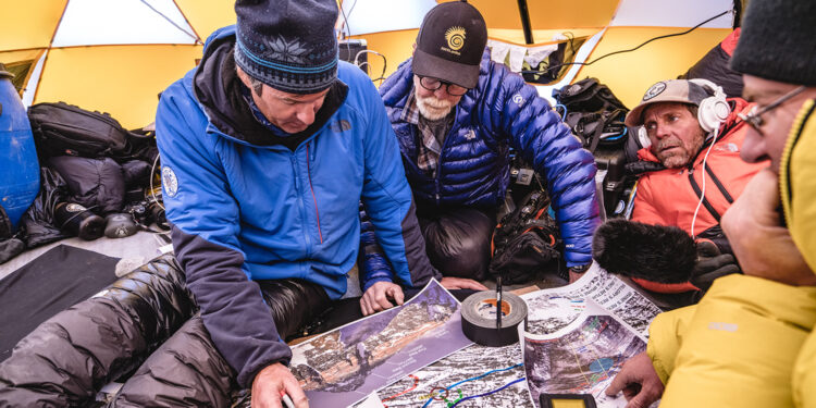 Mark Synnott, Thom Pollard, Jim Hurst, and Jamie McGuinness map out their plan to climb the North side of Mt. Everest in search of Sandy Irvine's remains. (Photograph by Renan Ozturk, National Geographic)