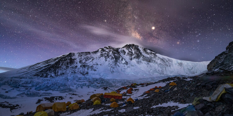 Advanced Base Camp, where more than 200 people sprawl across a quarter mile of glacial moraine. The summit is the rightmost peak, barely visible beyond the snowy saddle of the North Col (at right). (National Geographic/Renan Ozturk)