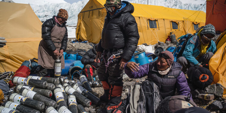 Sherpa team with gear and supplies during expedition to find Sandy Irvine's remains on Mt. Everest. (Photograph by Renan Ozturk, National Geographic)